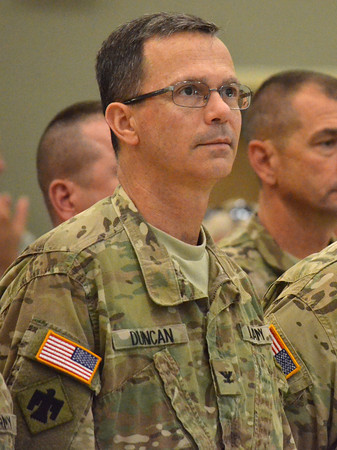 Lt. Col. Rex Duncan listens to Gen. Myles L. Deering as he welcomes troops home from Afghanistan Wednesday afternoon at the Armed Forces Reserve Center.<br /> Transcript Photo by Kyle Phillips
