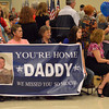 Family members hold a sign as they wait for their soldier before the start of the welcome back ceremony at the Armed Forces Reseve Center Wednesday.  Thirty troops returned home from Afghanistan.<br /> Transccript Photo by Kyle Phillips