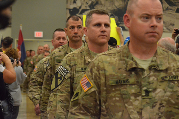 Oklahoma National Guard Troops march into the Armed Forces Reserve Center Wednesday morning as they arrive home from oversea's duty to waiting friends and family members.<br /> Transcript photo by Kyle Phillips