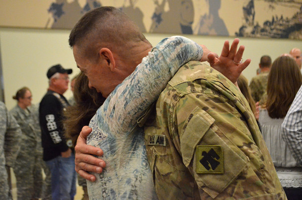 Col. Kevin Staring hugs his wife, Candy, during a welcome home ceremony for troops returning to Oklahoma from Afghanistan Wednesday morning at the Armed Forces Reserve Center.<br /> Transcript Photo by Kyle Phillips