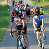 Riders take a turn at NE 48th Ave and Rock Creek Rd Saturday morning. Julie Bragg/ The Transcript