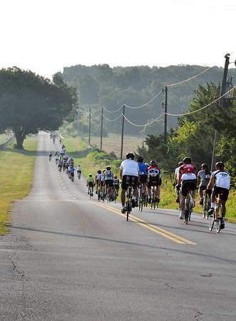 Bike riders head east on Rock Creek Rd Saturday morning. Julie Bragg/ The Transcript