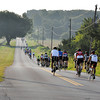 Bike riders head east on Rock Creek Rd Saturday morning. Julie Bragg/ The Transcript