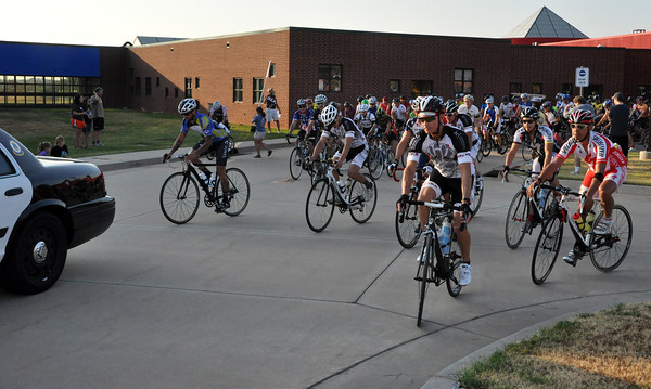 Bike riders leave the starting line located at the J.D. McCarty Center on E Main St. Saturday Morning. The riders had a police escort to prevent accidents. Julie Bragg/ The Transcript
