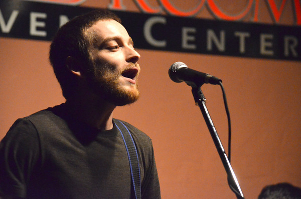 Clint Williams, bass player for Lotta Tuff, sings backup vocals during one of the band's songs Thursday as they play a show at the Red Room during the opening night of the Norman Music Festival.<br /> Transcript Photo by Kyle Phillips