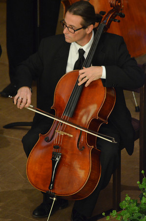 """A member of the  Norman Philharmonics plays the cello as the group plays  a concert Sunday afternoon at McFarlin Memorial United Methodist Church.  The concert that was performed was titled """"A Simple Gift"""".<br /> Kyle Phillips/The Transcript"""