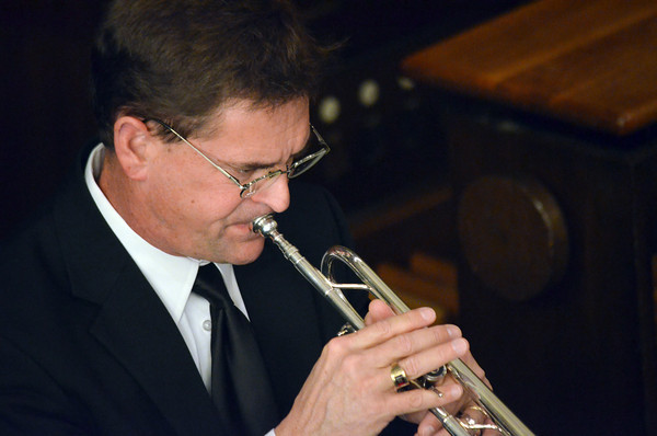 """Karl Sievers plays the trumpet during the Norman Philharmonic's concert Sunday afternoon at McFarlin Memorial United Methodist Church.  The concert that was performed was titled """"A Simple Gift"""".<br /> Kyle Phillips/The Transcript"""