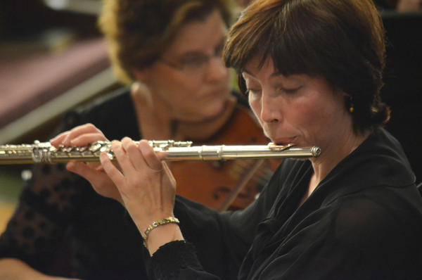 """Valerie Watts plays her flute as the Norman Philharmonics play a concert Sunday afternoon at McFarlin Memorial United Methodist Church.  The concert that was performed was titled """"A Simple Gift"""".<br /> Kyle Phillips/The Transcript"""