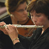 "Valerie Watts plays her flute as the Norman Philharmonics play a concert Sunday afternoon at McFarlin Memorial United Methodist Church.  The concert that was performed was titled ""A Simple Gift"".<br /> Kyle Phillips/The Transcript"