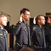 Norman Police recruits take their oath Friday afternoon during the Norman Police Academy graduation ceremony at Bethal Baptist Church.<br /> Transcript Photo by Kyle Phillips