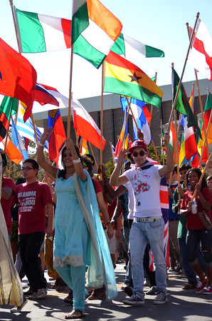 Students from the University of Oklahoma College of International Studies walk down Boyd Street Saturday during the University of Oklahoma homecoming parade.<br /> Kyle Phillips/The Transcript