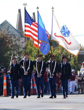 Members of the OU Army ROTC Color Guard carry the flags Saturday during the University of Oklahoma homecoming parade.<br /> Kyle Phillips/The Transcript