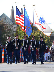 Members of the OU Army ROTC Color Guard carry the flags Saturday during the University of Oklahoma homecoming parade. Kyle Phillips/The Transcript