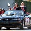 2011 homecoming King and Queen Corbin Carter and Laura Bock wave to the crowd as they ride down Boyd St. Saturday during the University of Oklahoma homecoming parade.<br /> Kyle Phillips/The Transcript