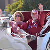 2012 parade marshall Tom Boyd, right, and his wife Barabara wave to the crowd as they ride down Boyd St.  Saturday during the University of Oklahoma homecoming parade.<br /> Kyle Phillips/The Transcript