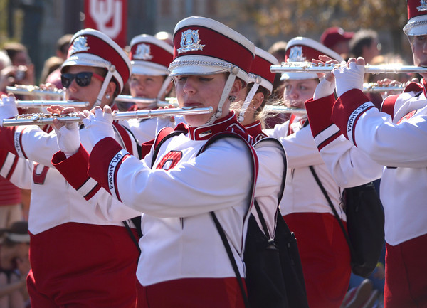 Members of the Pride of Oklahoma Marching Band play their instruments as they participate in the OU homecoming parade Saturday during the University of Oklahoma homecoming parade.<br /> Kyle Phillips/The Transcript