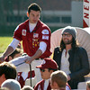 Kings of Leon drummer Ivan Nathan Followill rides into the ESPN College GameDay set on the Sooner Schooner Saturday morning on the south oval of the University of Oklahoma campus.<br /> Kyle Phillips/The Transcript