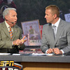 College GameDay commentator Lee Corso, left, and Kirk Herbstreit discuss the OU/Notre Dame game Saturday as the show broadcasts from the south oval on the University of Oklahoma Campus.<br /> Kyle Phillips/The Transcript