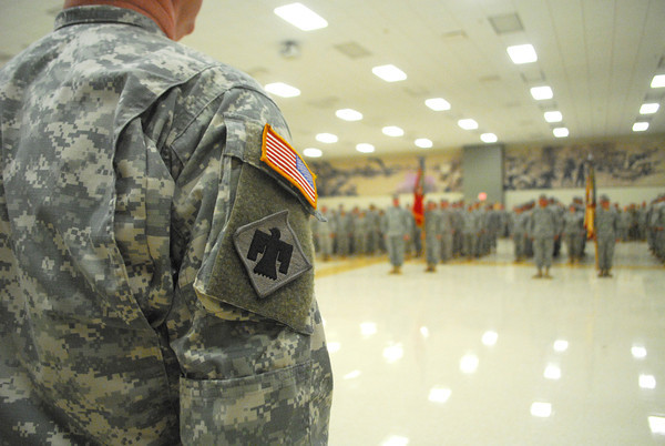 Members of Oklahoma National Guard stand at attention Sunday during the change of command ceremony for the 45th Infantry Brigade Combat Team at the Norman Armed Forces Reserve Center. <br /> Kyle Phillips/The Transcript