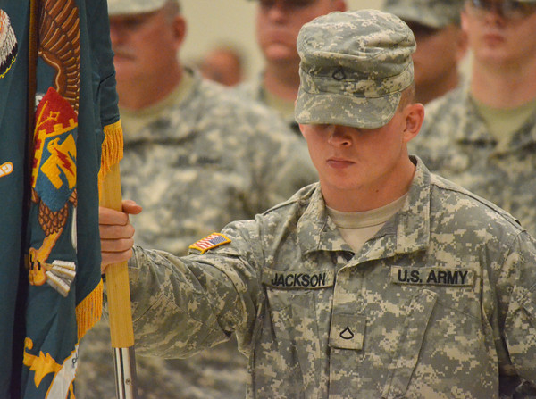 A National Guard soldier holds his platoon's flags Sunday during the change of command ceremony for the 45th Infantry Brigade Combat Team at the Norman Armed Forces Reserve Center. <br /> Kyle Phillips/The Transcript