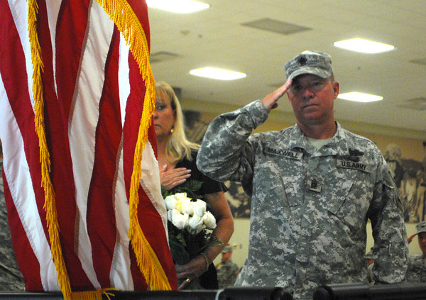 Sgt. Maj. Robert Maxwell salutes the flag during the National Anthem Sunday during the change of command ceremony for the 45th Infantry Brigade Combat Team at the Norman Armed Forces Reserve Center. <br /> Kyle Phillips/The Transcript