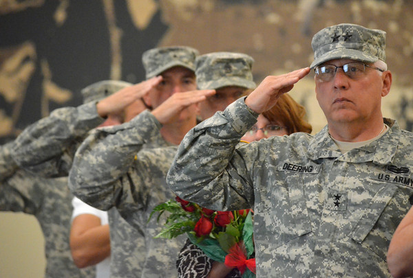 Maj. Gen. Myles Deering salutes the flag as the National Anthem is played during the change of command ceremony for the 45th Infantry Brigade Combat Team at the Norman Armed Forces Reserve Center. <br /> Kyle Phillips/The Transcript