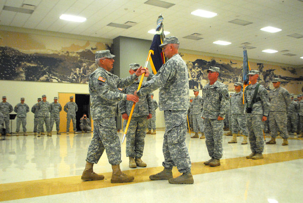 Maj. Gen. Myles Deering, left,  hands over the Battallion Colors to Col. Van L. Kinchen Sunday during the change of command ceremony for the 45th Infantry Brigade Combat Team at the Norman Armed Forces Reserve Center. <br /> Kyle Phillips/The Transcript