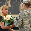 Crystal Kinchen,  wife of Col. Van Kinchen, receives a bouqet of flowers for all she has done while her husband was serving overseas during the change of command ceremony for the 45th Infantry Brigade Combat Team at the Norman Armed Forces Reserve Center. <br /> Kyle Phillips/The Transcript