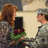 Debbie Ward, wife of Col. Joel Ward, receives a bouqet of flowers for all she has done while her husband was serving overseas during the change of command ceremony for the 45th Infantry Brigade Combat Team at the Norman Armed Forces Reserve Center. <br /> Kyle Phillips/The Transcript