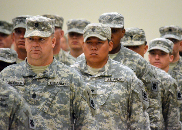 Oklahoma National Guard soldiers stand at attention  during the change of command ceremony for the 45th Infantry Brigade Combat Team at the Norman Armed Forces Reserve Center. <br /> Kyle Phillips/The Transcript