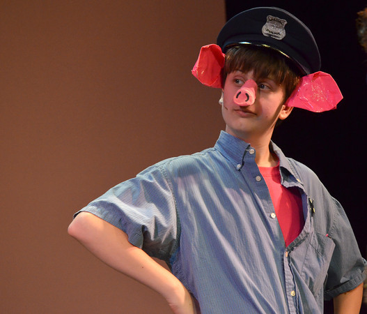 "Brady Bell plays the part of Hank Hamhock during the rehersal of ""Piggy Nation"" Wednesday evening at the Sooner Theatre.  The play opens Friday and will run all weekend at the Sooner Theater.<br /> Transcript Photo by Kyle Phillips"