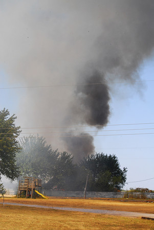 Smoke rises up on Indian Hills Road as a wildfire burns the area Thursday afternoon.<br /> Kyle Phillips/The Transcript