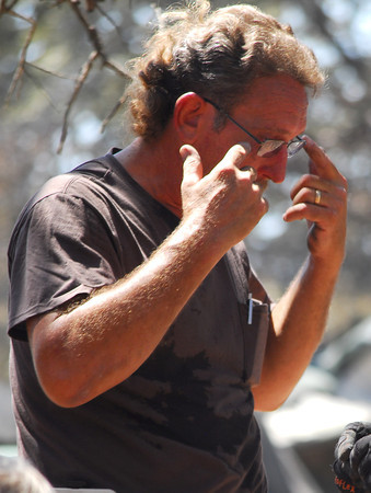 Neal Wood wipes tears away from his eyes as he buries his dogs that died  in the fire that hit Cleveland County Friday.  Five of Wood's eight dogs survived the fire.<br /> Kyle Phillips/The Transcript