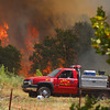 Noble firefighters keep an eye on a flair up off 120th Ave Saturday afternoon as they try to keep control of the blaze threatening Noble.<br /> Kyle Phillips/The Transcript