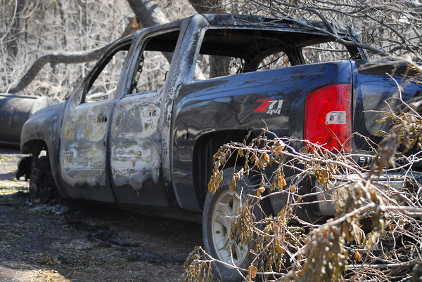 A damaged truck sits next in a driveway at 12861 Maguire Road Saturday afternoon.<br /> Kyle Phillips/The Transcript