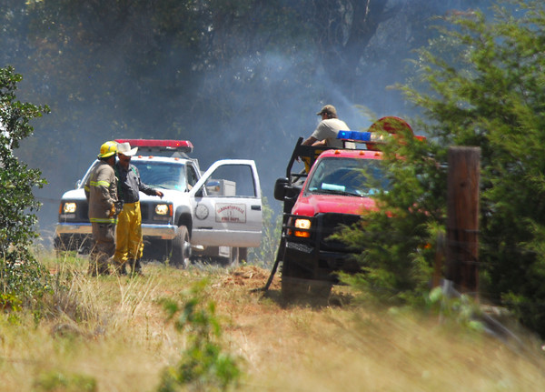 Firefighters re-group and get ready to attack a fire on 120th Ave. and Etowah Road Saturday afternoon as they and other crew try to get a wildfire under control in Cleveland County.<br /> Kyle Phillips/The Transcript