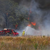 A Cedar County fire crew battles a fire on Cemetery Road Friday afternoon as a wild fire burns in south Cleveland County.<br /> Kyle Phillips/The Transcript