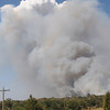 Smoke rises into the air Friday, Aug. 3, 2012, as firefighters from several central Oklahoma departments fight a wildfire in the eastern part of the county.  Jerry Laizure / The Transcript