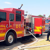 A Norman fire engine and tanker refill their water tanks at the water tower at Thunderbird casino  Friday, Aug. 3, 2012, while fighting a wildfire in the eastern part of the county.  Jerry Laizure / The Transcript
