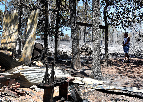 The grass fire that started on Friday afternoon caused damages to many homes and trees around the surrounding areas. Julie Bragg/ The Transcript