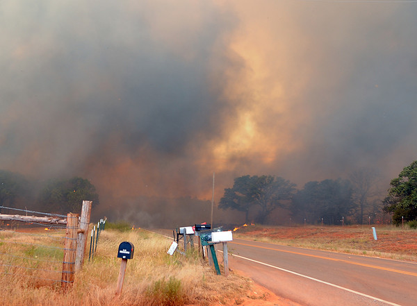 A wildfire jumps Etowah Road Friday, Aug. 3, 2012,  in the eastern part of the county.  Jerry Laizure / The Transcript