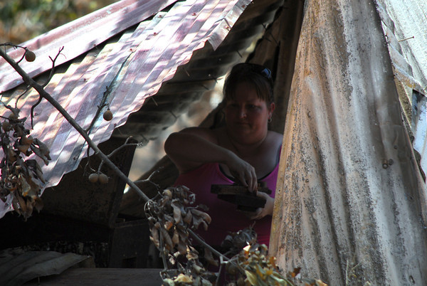 Angel Pearce digs through her parent's shed Sunday afternoon as she tries to salvage something from the property which was burned in the wildfire that hit Cleveland County over the weekend.<br /> Kyle Phillips/The Transcript