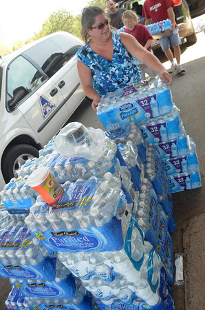 Cynthia Freeman loads up water foor the Norman Emergency Response team to deliver to firefighters in the field Saturday afternoon.  Many departments are on the front lines in Cleveland County trying to get a wildfire under control.<br /> Kyle Phillips/The Transcript