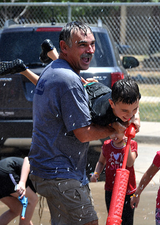 Deacon Steve Lewis, former Fire Fighter, organized the Norman Fire Department to come after the St. Joseph's Totus Tuus for children to cool down on Friday.