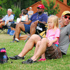 Darren Ransley and his daughter Layla settle in at Lions Park to listen to Beau Jennings and the Tigers Sunday at the Summer Breeze Concert Series.<br /> Kyle Phillips/The Transcript