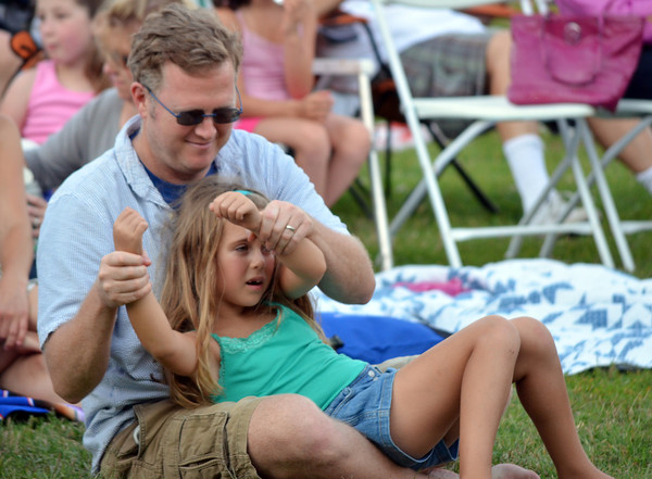 Peter Gries and his daughter Julia dance to the music of Alegria Real Sunday evening at the first show of the Summer Breeze Concert Series at Lions Park.<br /> Kyle Phillips/The Transcript