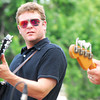 Jarod Evans plays his guitar during the Beau Jennings and the Tigers concert at Lions Park during the Summer Breeze Concert Series Sunday.<br /> Kyle Phillips/The Transcript