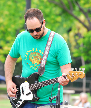Bassist Brine Webb plays his instrument Sunday evening as Beau Jennings and the Tigers perform at the Summer Breeze concert in Lions Park.<br /> Kyle Phillips/The Transcript