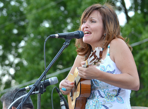 Christina Audas plays the guitar and sings as the band  Alegria Real plays a show  Sunday evening at the first concert of the Summer Breeze Concert Series at Lions Park.<br /> Kyle Phillips/The Transcript