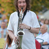 Eric Walshop plays the sax as he wanders through the crowd as the band  Alegria Real plays a show  Sunday evening at the first concert of the Summer Breeze Concert Series at Lions Park.<br /> Kyle Phillips/The Transcript